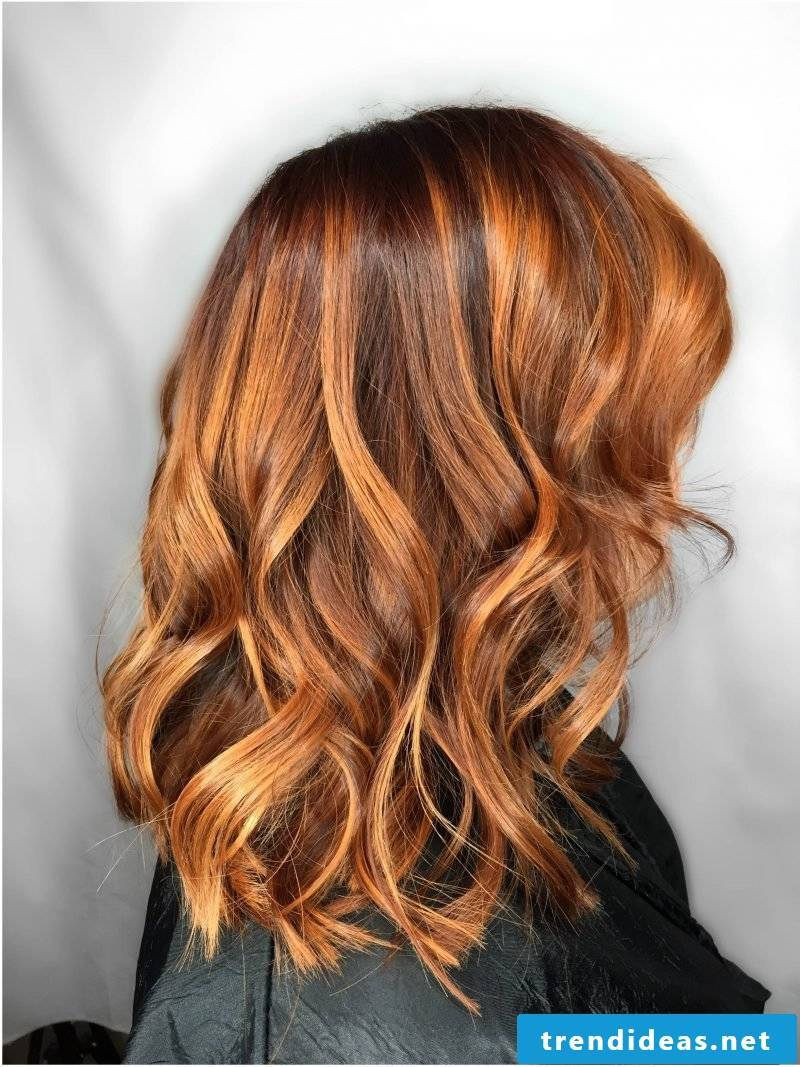 Copper brown hair color with blond strands