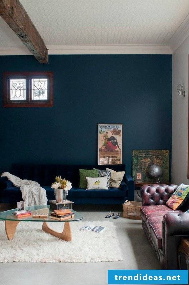 Petrol color wall paint in the living room
