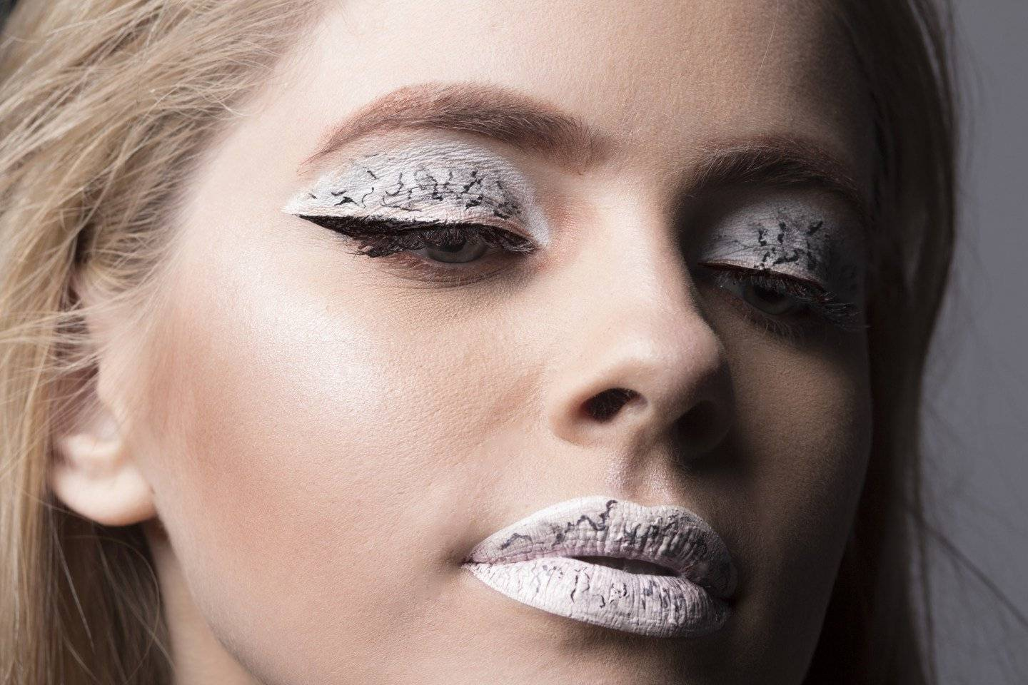 Apply marble lipstick and eyeshadow