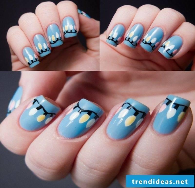 Nail art design for Christmas fairy lights blue
