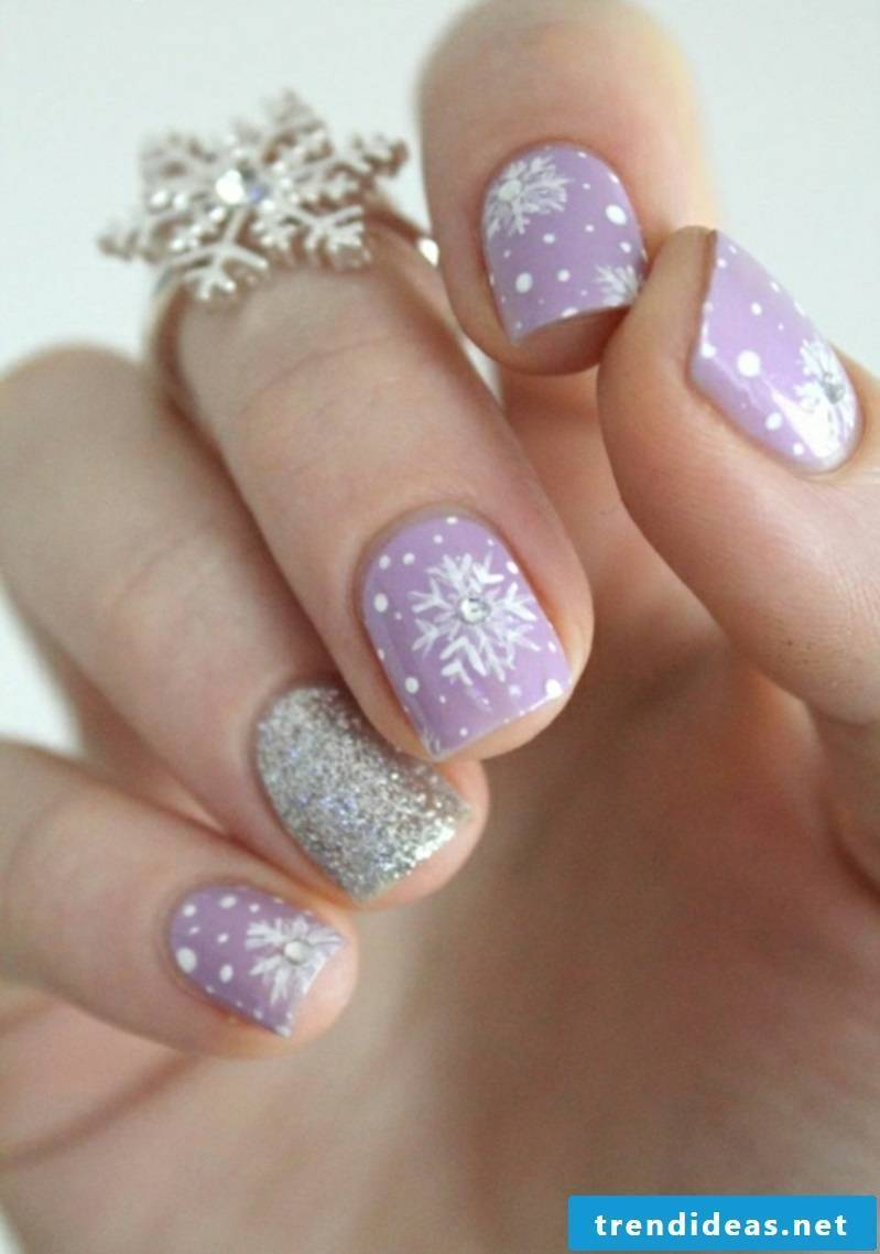 Nail art design on a Christmas purple background