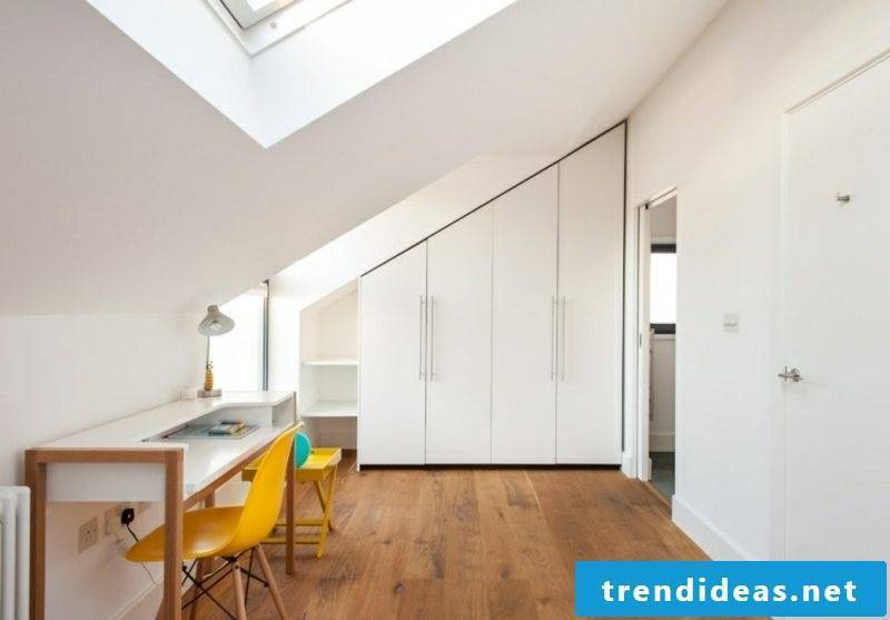 white wardrobe walk-in room with sloping ceiling