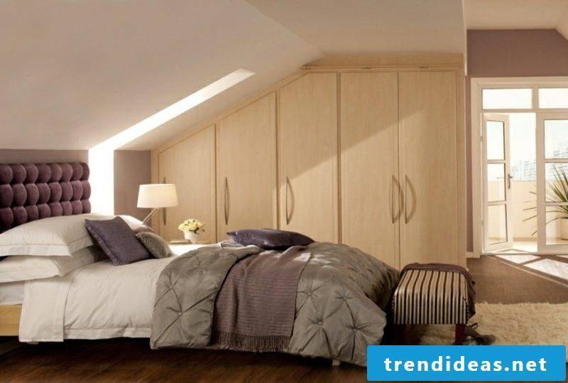 walk-in wardrobe under sloping roof light wood