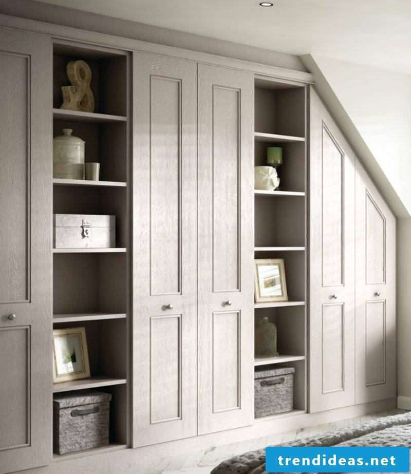 classic walk-in closet in light-wood sloping roof