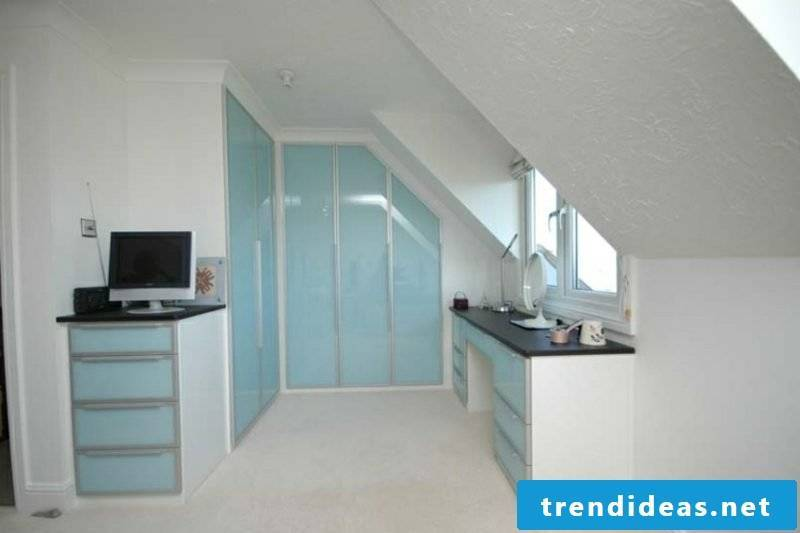 walk-in wardrobe under sloping roof light blue