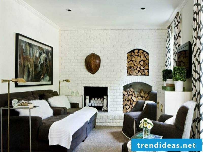 dark furniture in front of the wall design with white bricks