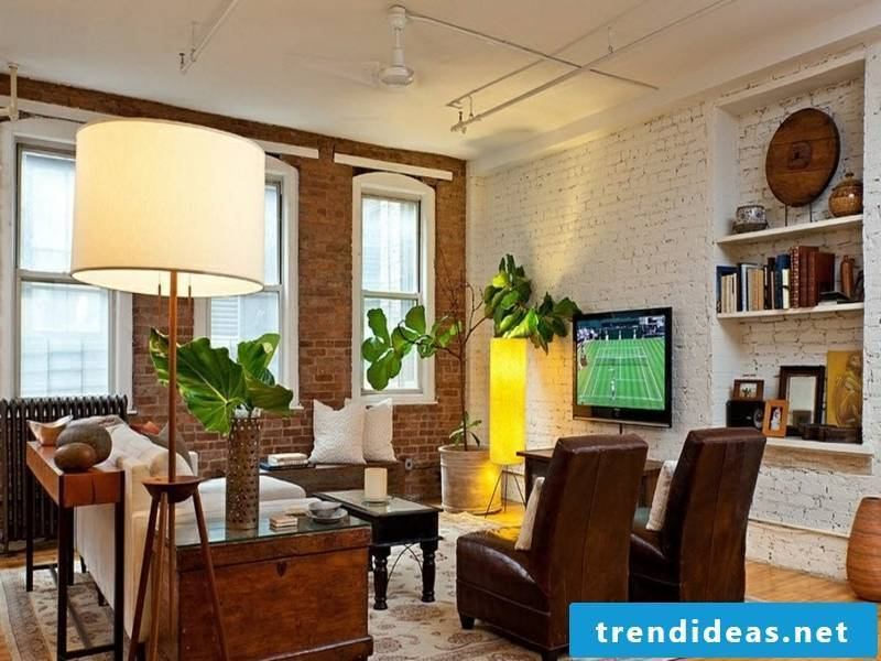 Interior with leather armchair and wall design with white bricks