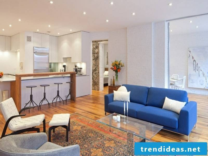 Blue sofa in a room with wall design with white tiles