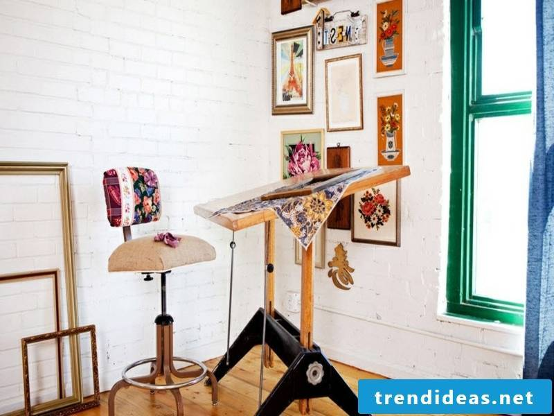 Colorful pictures on the wall design with white bricks
