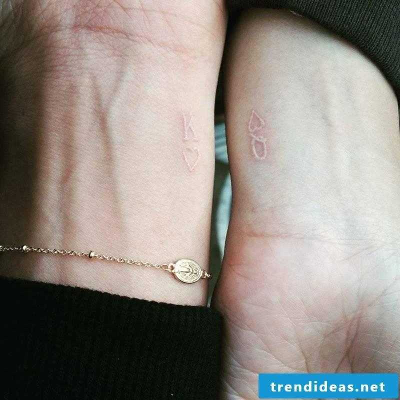 white tattoo couple