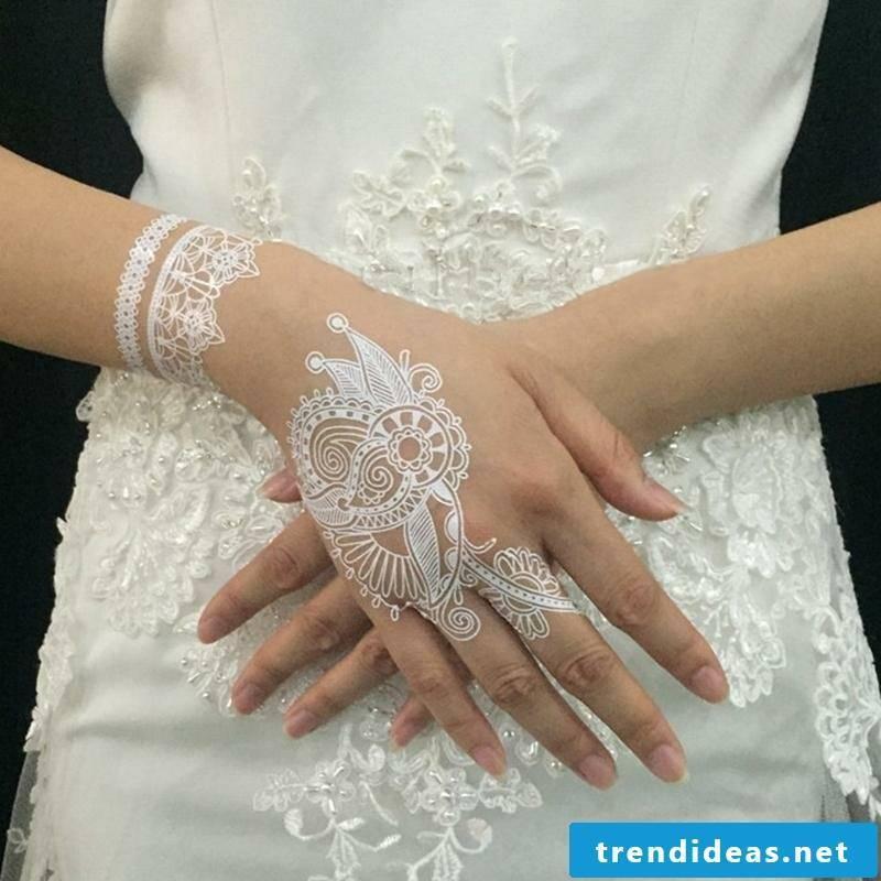 Wedding ring tattoo white