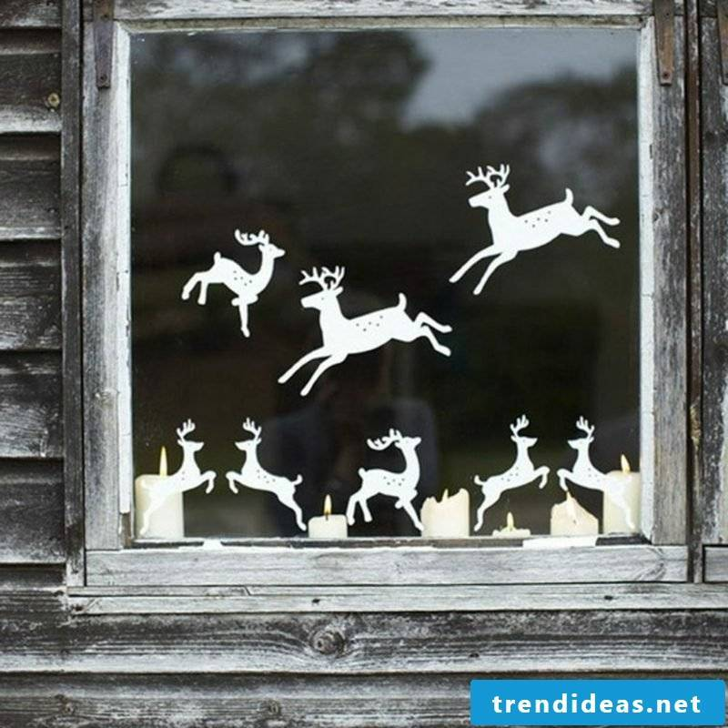 Window pictures for Christmas paper deer burning candles