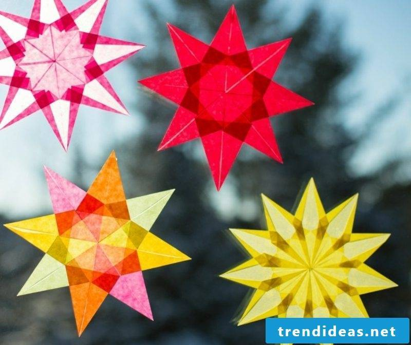 Window pictures for Christmas colorful stars made of paper