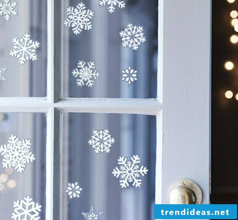 Window pictures for Christmas delicate snowflakes made of paper