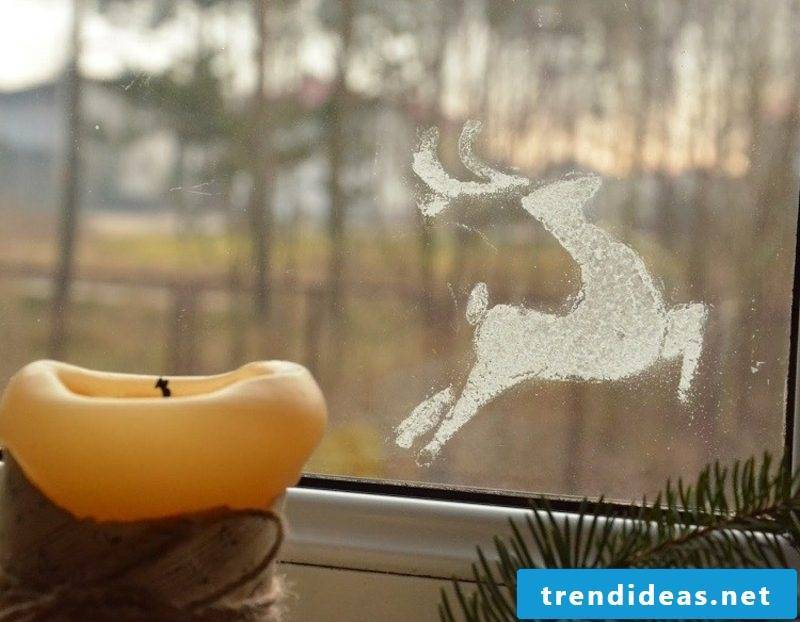 Window pictures for Christmas Deer made of artificial snow