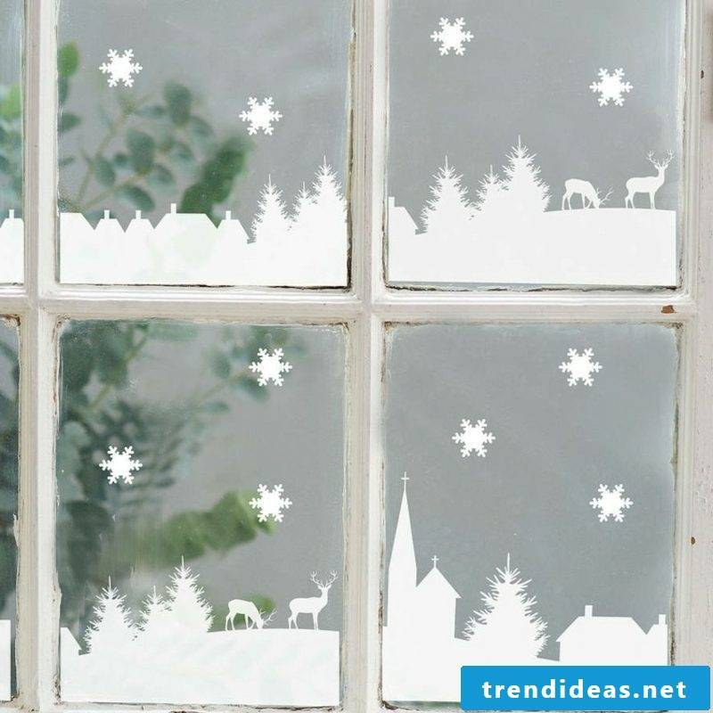 Window pictures for Christmas city made of artificial snow