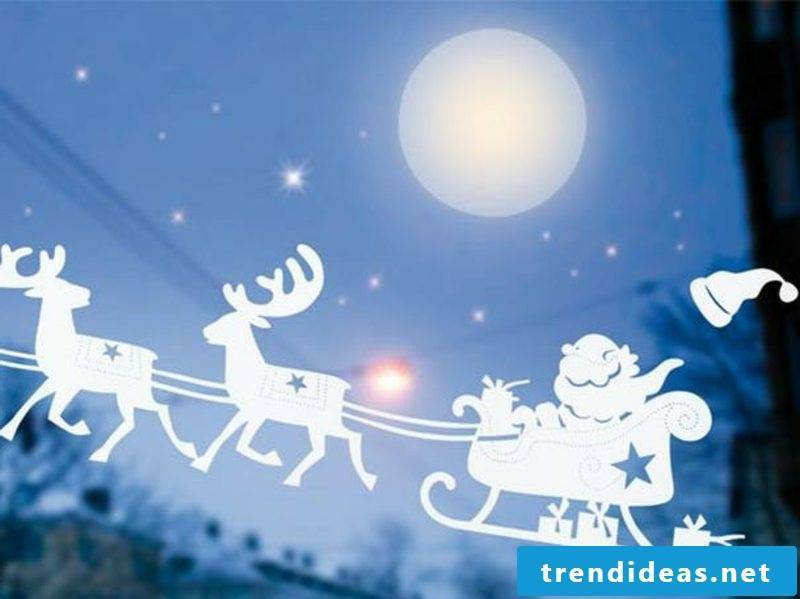 Window pictures for Christmas Santa Claus and his reindeer