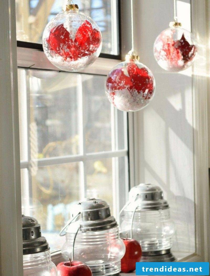 Window pictures for Christmas red Christmas baubles and candle lanterns