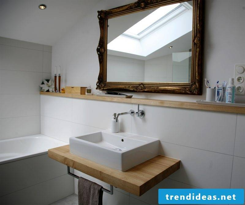 wooden vanity top in rustic bathroom combined with large vintage mirror
