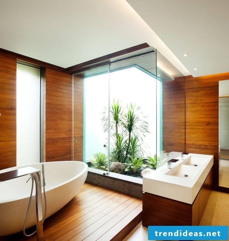 wooden vanity top in wood bathroom with room palms