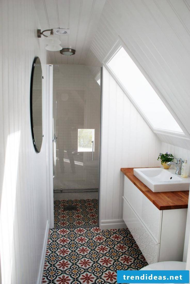 Wooden vanity top in a small white bath gives a beautiful accent