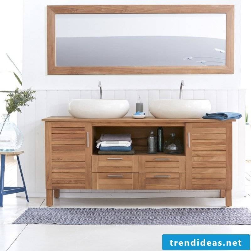 wooden vanity top in bright bathroom with plain deco ornaments
