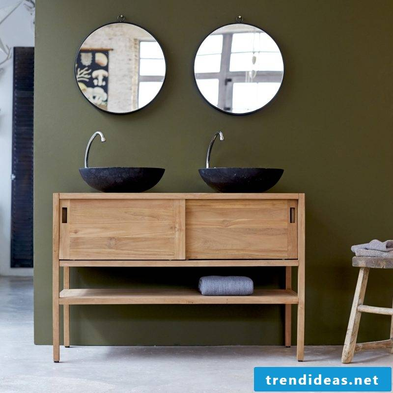 wood vanity top in combination with extravagant mirrors creates a fancy effect