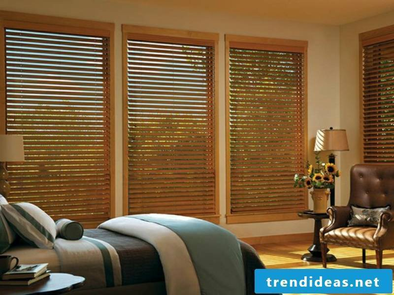 Bedroom with wooden blinds