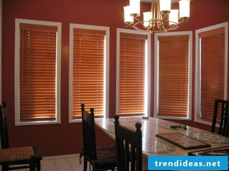 Elegant dining room with wooden blinds