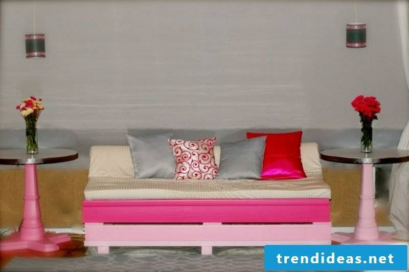 Pallet sofa originally painted pink